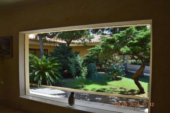Palmasera Village Resort : Giardino interno blocco centrale Palmasera