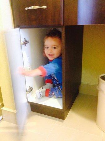 Homewood Suites Sudbury Ontario: Playing in the vanity cupboards :)