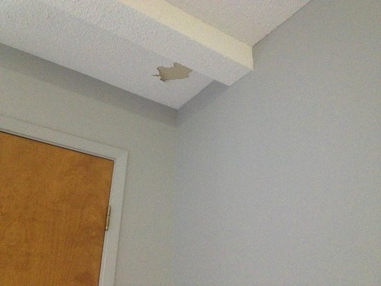 Ambassador Hotel & Conference Centre: hole in the popcorn ceiling