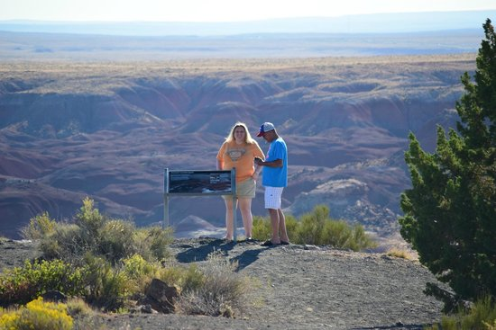 Painted Desert : My uncle and I reading a sign.