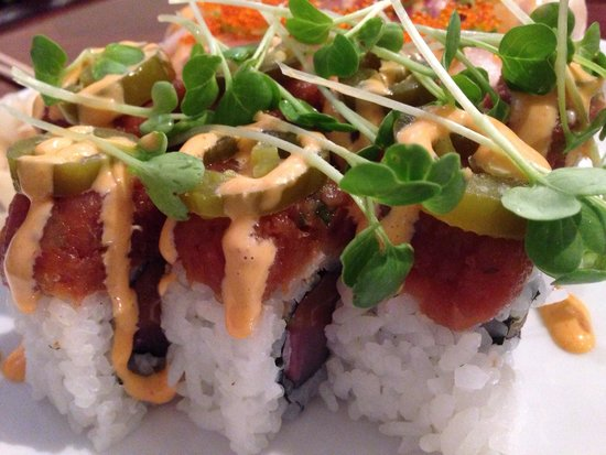 "Sen Dai Sushi: Sun roll - ""spicy yellowtail, tobiko, green onion, avocado roll"" topped with tuna, salmon, shich"
