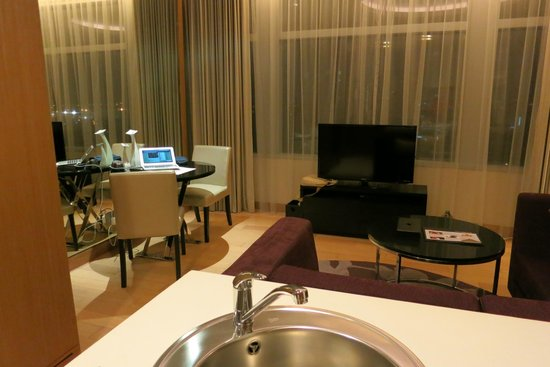 Marriott Executive Apartments Bangkok, Sukhumvit Thonglor: Living room with table, tv , couch out of view