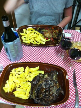 Asador Iñaki: Chuletón steak, a leg of lamb and wine in a chiller
