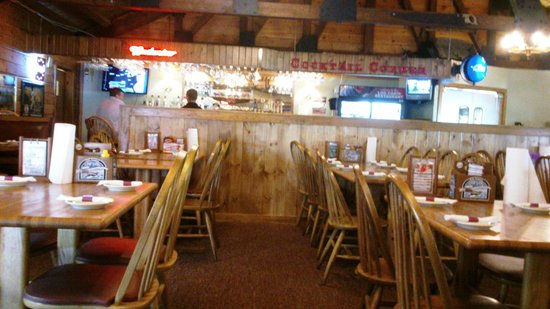 Tr s bien picture of the log cabin restaurant bar for Log cabin cafe