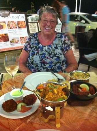 Bollywood Indian Restaurant : Smiling because the food is so good!!