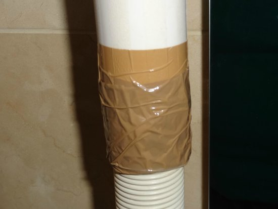 Hyde Park Suites: I think that the bathroom pipe fixed with wrapping tape says it all