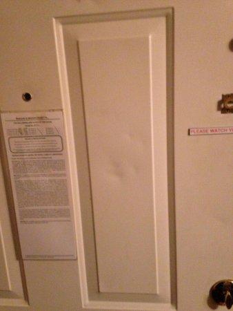 Knights Inn Boston/Danvers: Damage on the back of the door...