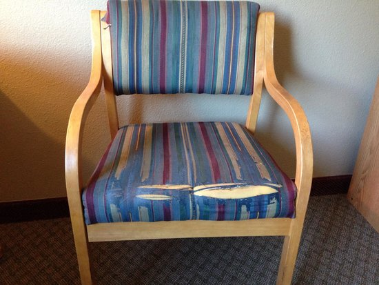 Super 8 Kremmling: Torn chair cover