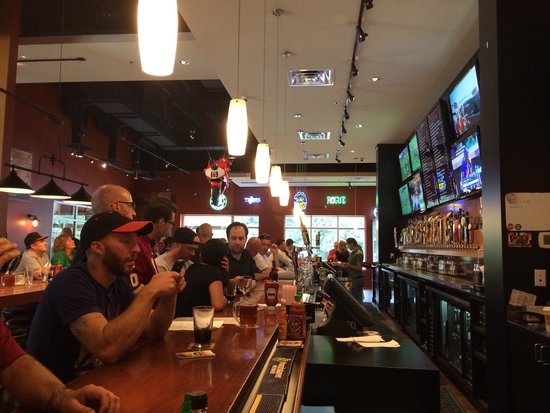 Frisco Tap House and Brewery: Frisco Tap House - along the bar during football season from the end corner.