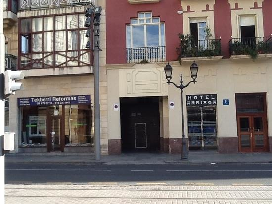 Entrance to car parking one street away from hotel for Hotel bilbao jardines