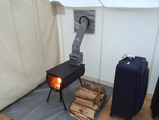 Under Canvas Glacier Wood Stove in Deluxe Tent & Wood Stove in Deluxe Tent - Picture of Under Canvas Glacier Coram ...