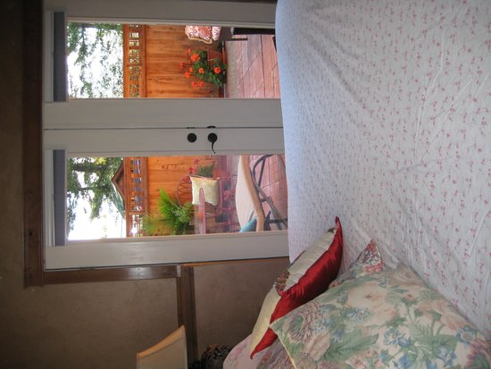 Whitefish TLC Bed and Breakfast Inn: View across the king bed to patio