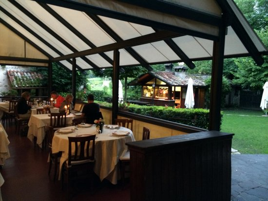 Antico Casale Tre Camini: Inside Tre Camini with view of out door dining and view of forno in the giardino
