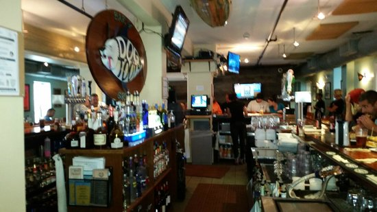 Dog Tooth Bar & Grill: The Dogtooth logo is based on a real fish w/sharp teeth. Strong swimmer with a powerful dorsal f