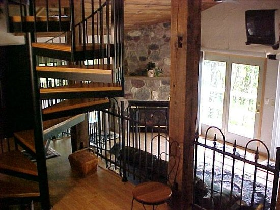 Percheron Paradise Romantic Hideaway: Chalet #2 fireplace and spiral staircase