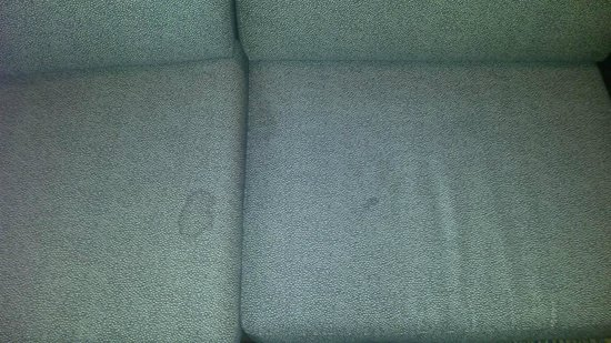 Residence Inn Buffalo Amherst: If the average person were to lay with their head on the couch this stain falls around the pelvi
