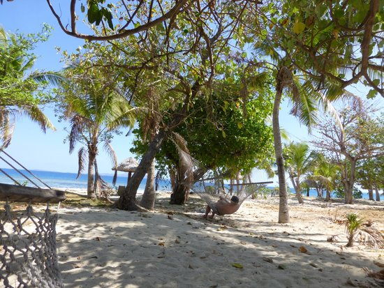 Treasure Island Resort: view from hammocks to beach, in front of bure