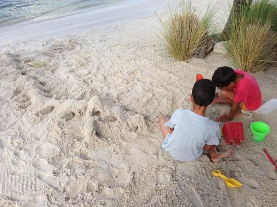 La Maya Beach Luxury Apartments : My kids building sandcastles and mountains on the beach