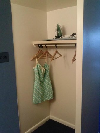 Belvedere Beach Resort: The Dress Hanging is ours. Room included Iron and Ironing Board