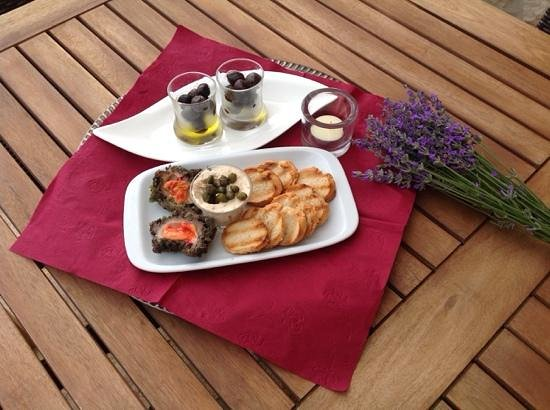 Tasty treats at Fox Apartments. Sea eggs & fish pate with braised olives