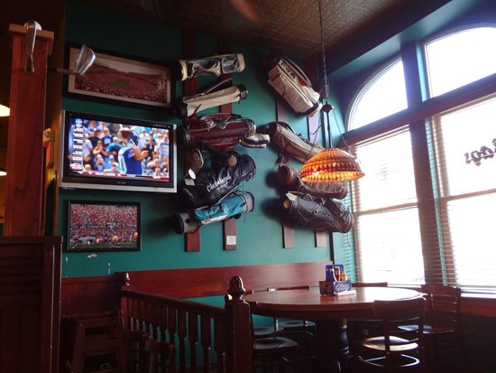 Bags Sports Pub: Reason they call it Bags...golf bags hanging everywhere.  Decor is antique and authentic.
