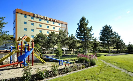 Dinler Hotels - Nevsehir: General View of Main Building from Children's Playground