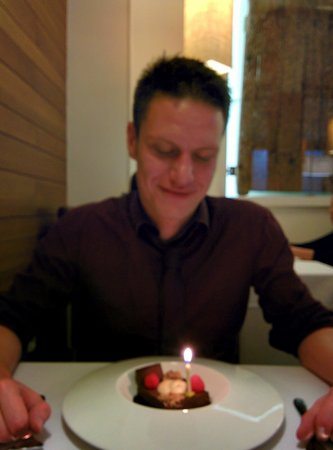 ‪‪La Era Restaurante‬: Birthday boy with his dessert and candle!‬