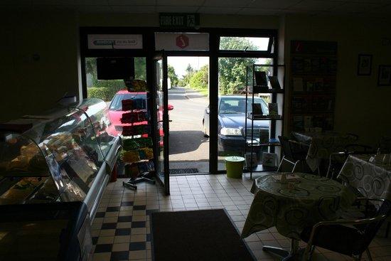 Earls Café: Doorway, book rack.