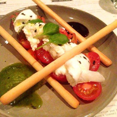 D.O.C Pizza & Mozzarella Bar: Caprese salad - heirloom tomatoes, D.O.M buffalo mozzarella, Black Sea salt, pesto.