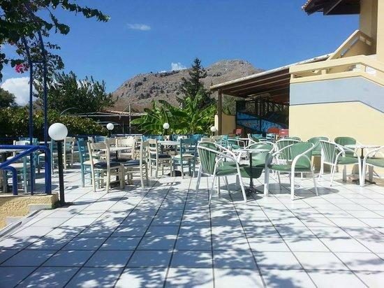 Golden Odyssey Kolimbia: Outdoor seating area near bar
