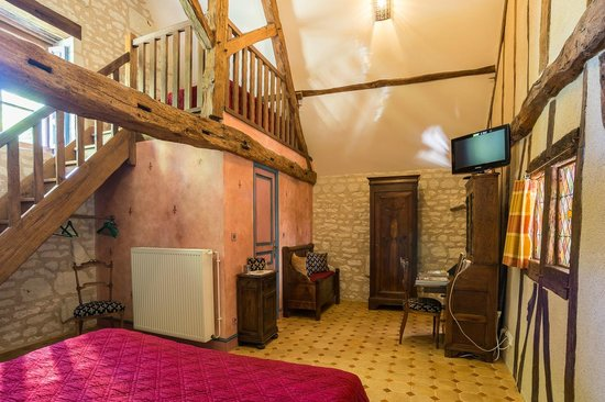 La Milaudiere: The Medieval room of La Milaudiere, with a bed upstairs the en-suite bathroom.