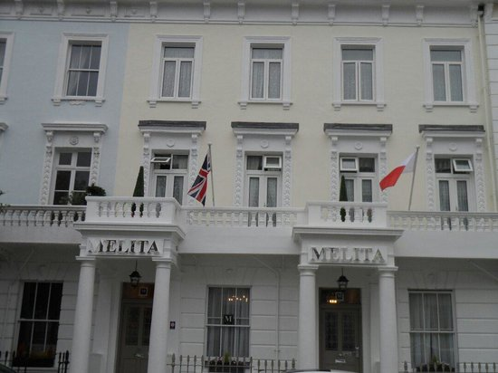 The Melita: Melita House Hotel displaying the Maltese flag and the UK flag being the 50th anniversary of Mal