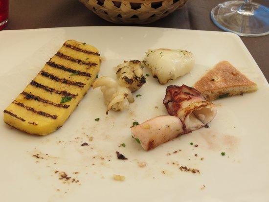 Trattoria Alla Ferrata: grilled calamari and polenta, looked much nicer before I ate half