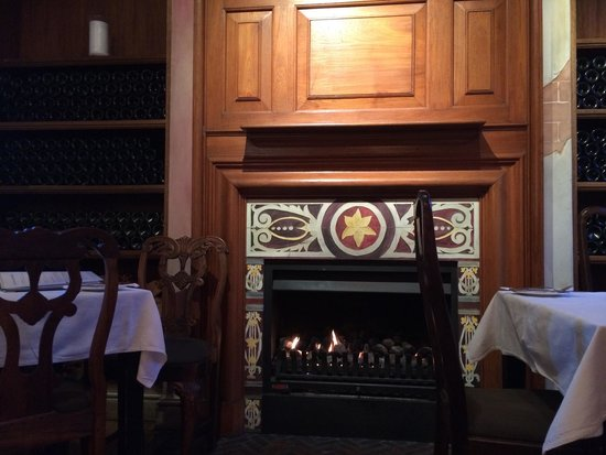 The Annex: Fireplace by the table. Warmth and atmosphere in union.