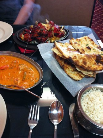 India Clay Oven: Chicken Tikka Masala w/ rice, Garlic Naan, and Chicken Tandoori