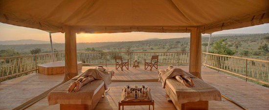 Mara Bushtops: open treatment tents overlook the natural salt lick
