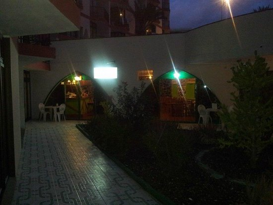 Guinea Apartments: bar/cafe by night