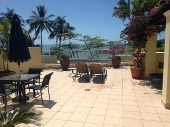 Sea Change Beachfront Apartments: Our private roof terrace overlooking pool and beach with BBQ hut to right