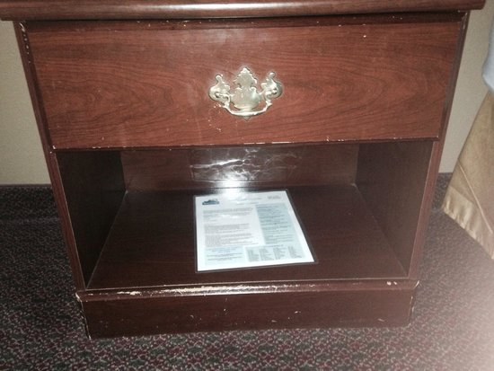 Travelodge Seattle University : Furniture you get for $121-179/night.  Info card sticky with god knows what.
