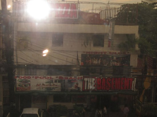 The Pub Hotel: View down the National Highway. They covered the window with plastic.