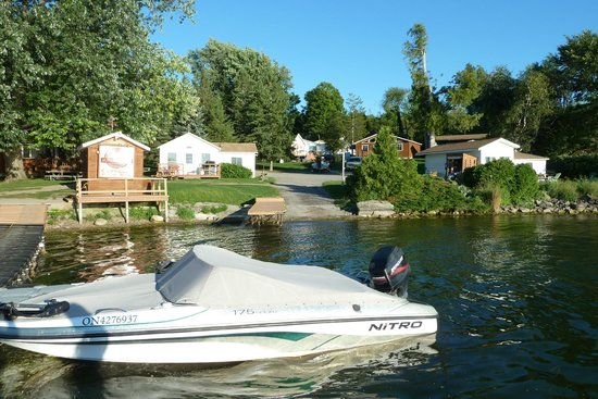 Merland Park Cottages: View of the numerous cottages and fish cleaning station from the dock