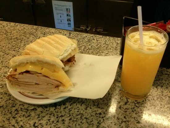 Cervantes: the pork pineapple and cheese sandwich with a fresh juice
