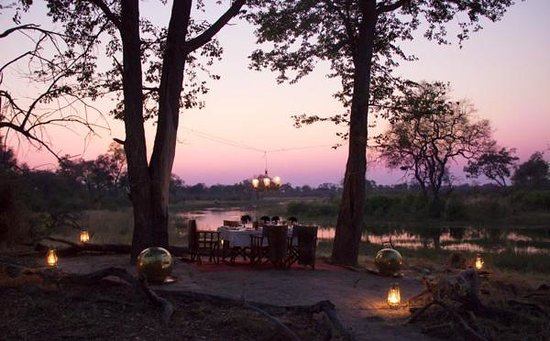 Great Plains Conservation Selinda Explorers Camp: romantic dinner under a candle chandelier
