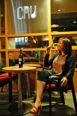 Cru Wine Bar: Enjoying one of Cru's amazing wines