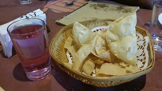 Grand Hotel Restaurant: The soothing welcome drink (Dahashamani) along with crispy Papadoms