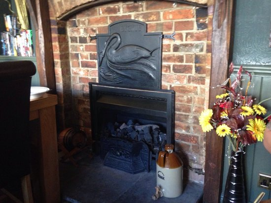 The Black Swan: The 'black swan' fireplace - bet this is lovely in the winter.