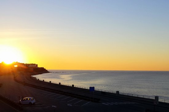 """Jonathan's Hotel """"On the Oceanfront"""": sunrise off our balcony!"""