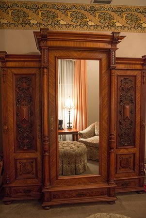 Morrison-Clark Historic Inn: Wardrobe that held the TV facing the chairs in sitting area