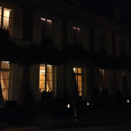 The golden glow of the windows at Hotel Le Manoir les Minimes at night in Amboise, France