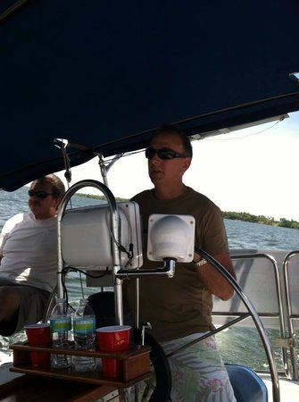 At the Helm Sailing Charters : My husband at the wheel